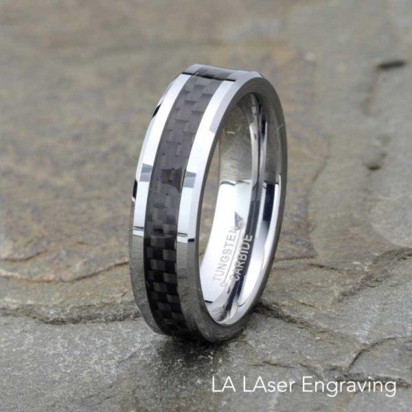 Polished tungsten carbide wedding band black carbon fiber inlay beveled edge